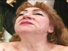 Fleshy old tart fucks herself with dildo dreaming of real cock.