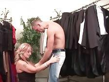 Cock loving mature blonde Joanna Depp seduces cute guy in clothes store.