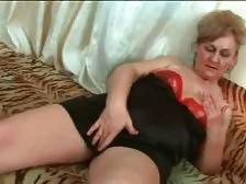 Fleshy blond granny is caressing herself dreaming of nice hard dick.