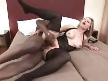 Busty blond granny Magda enjoys huge black cock in her hole.