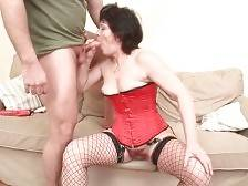 Aged brunette passionately sucks younger guy`s shaft.