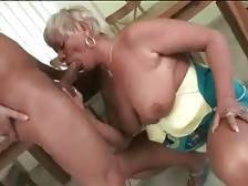 Slutty granny skillfully works her mouth at lover`s juicy cock.